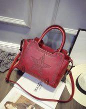 yıldız desenli zımbalı şarap kırmızısı kol çantası sk10972